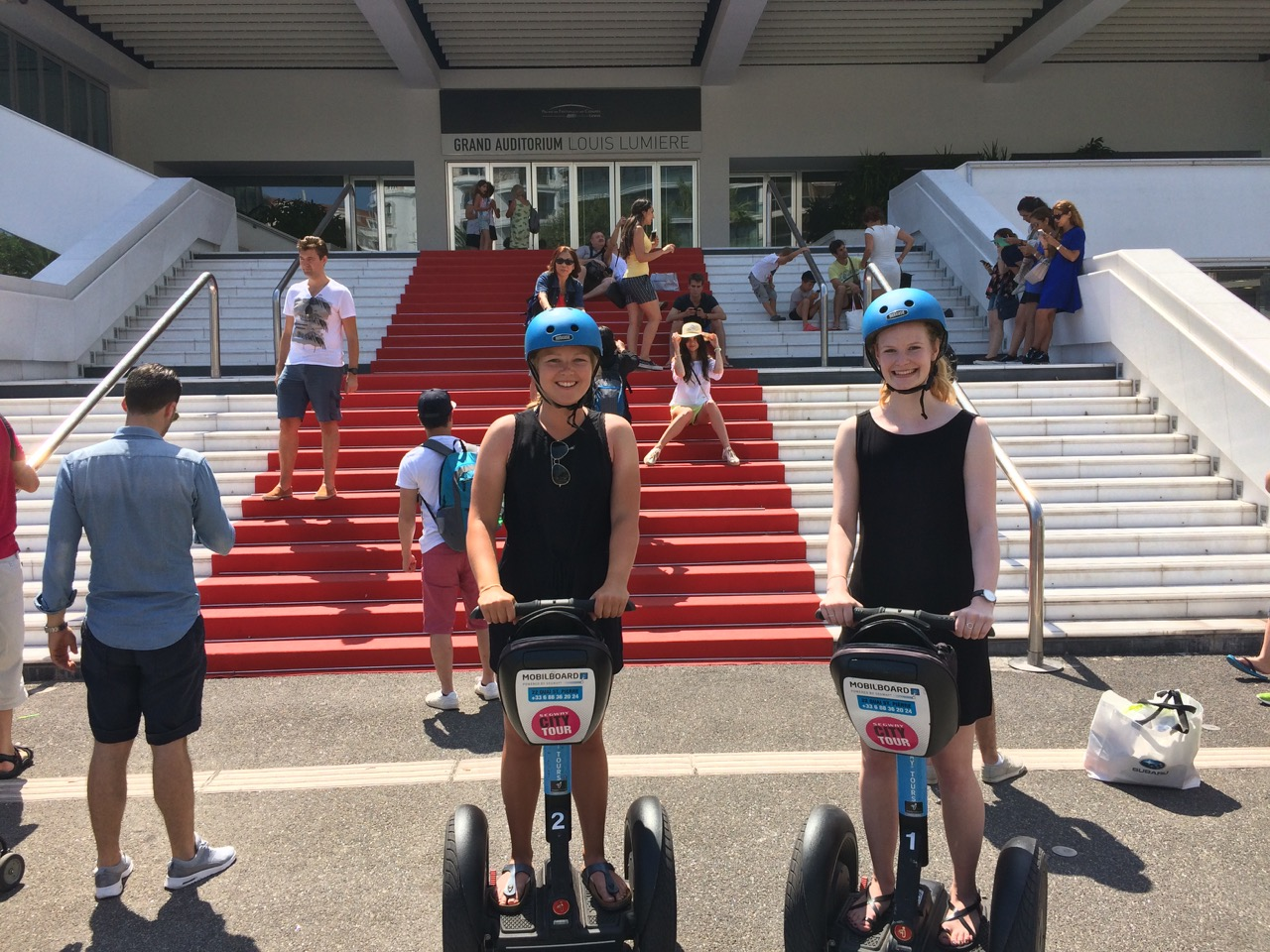 City Tour by MobilBoard Segway Cannes - in front of the Palais des Festivals, photo stop on the steps