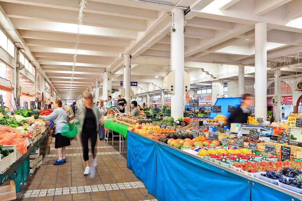 Forville Market in the hundred year-old covered market building and local producers' stalls